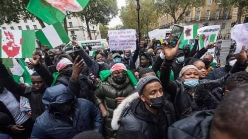 BREAKING: Buhari Must Return Home. -Nigerians Storm Buhari's Residence In UK,